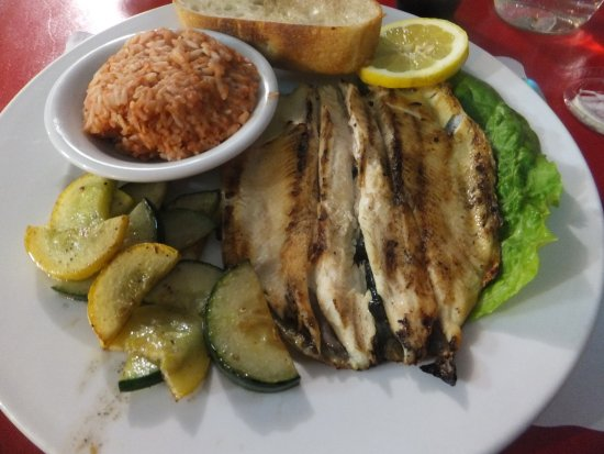 Shoshone, CA: Grilled Rainbow Trout in lemon with the Tomato Rice