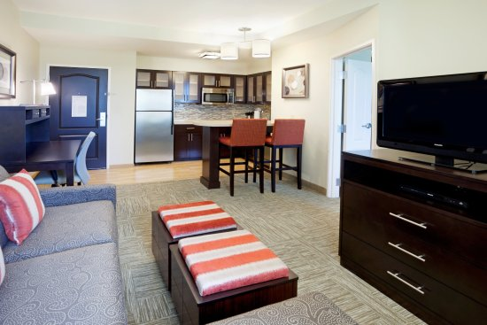 Staybridge Suites Stone Oak: Living room area and kitchen in our 1 bedroom suites