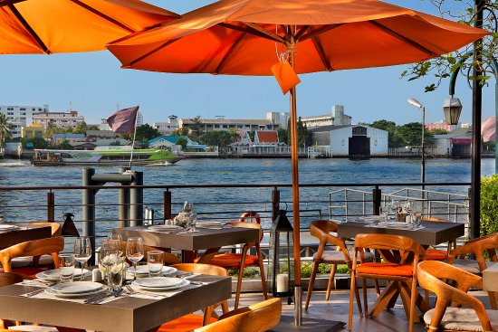 Riva Surya Bangkok: babble & rum terrace - a perfect spot for outdoor dining & watching sunset