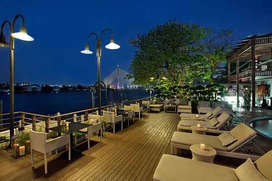 Riva Surya Bangkok: Pool Deck - riverside sunbath area in the day time and spectacular dining area in the evening