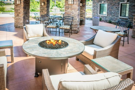 Corona, CA: Patio with fire pit and gas grill.