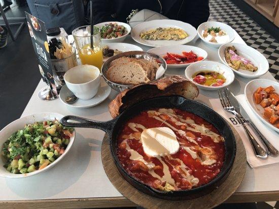 Kfar Saba, Israel: Shakshuka with eggplant and feta cheese, and a vegan breakfast (substituted with eggs)