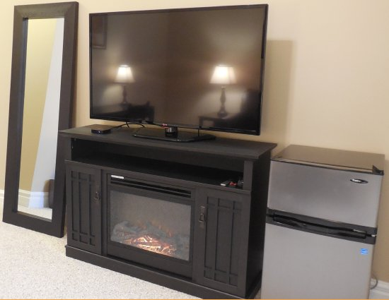 All Suites Have Electric Fireplace and Mini Fridge - Picture of ...