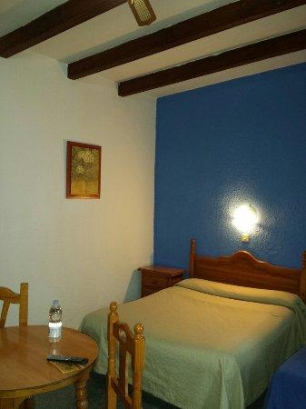 Detalle de la habitación. Hostal Río Grande en San Roque...