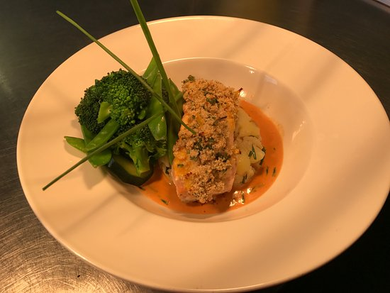 Saxmundham, UK: Pan fried fillet of salmon, topped with a lemon parsley crust, set on crushed new potatoes with