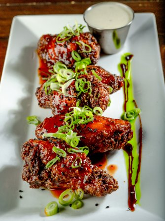 Lynn, Массачусетс: Our signature house wings that are Ryan & Wood smoked served with a taragon blue cheese dip.