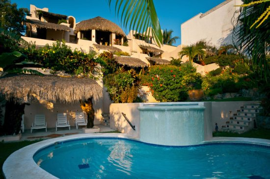 The ocean facing side and pool of Agua Azul la Villa, each room and terraza is on its own level