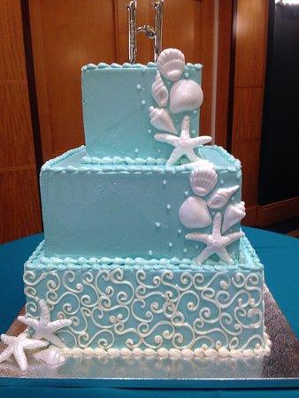 Salisbury, MD: Teal wedding cake with cascade or sea shells