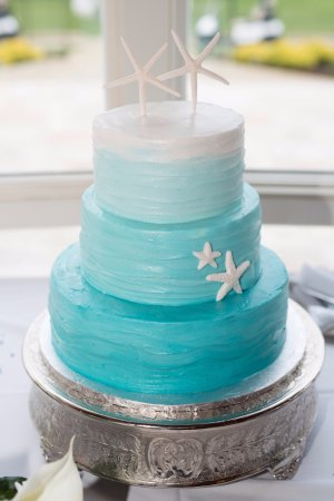 Salisbury, MD: Ombre teal wedding cake with wavy butter cream and starfish