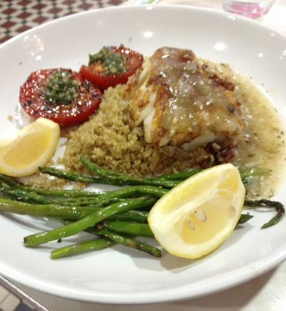 Rockville, MD: Summertime Cod entree with quinoa, asparagus, scrumptious tomatoes.