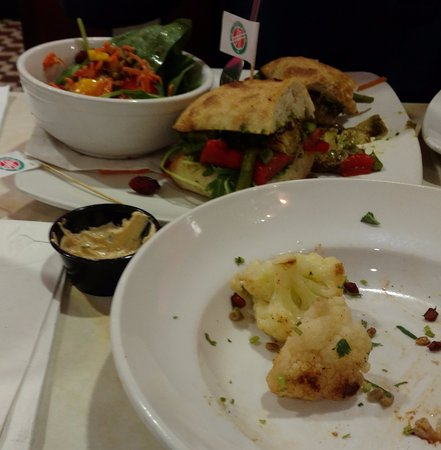 Rockville, MD: Back: Roasted Veggie Ciabatta with citrus salad. Front: Part of Cauliflower Tangier appetizer.