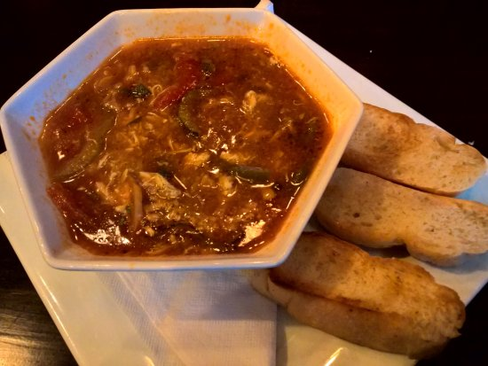 Decatur, GA: Yummy Arroz con Pollo Soup (Chicken soup with rice) accompanied by Cuban bread slices
