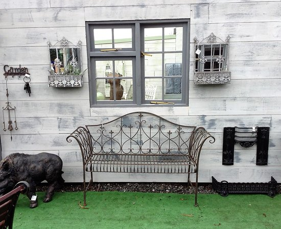 Little Budworth, UK: Reclaimed panelling, on old window and a bench - a focal point for the garden