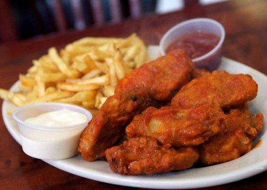 Hot chicken wings and fries