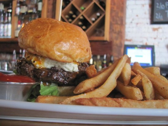 Claremont, Nueva Hampshire: Our 1/2 pound burgers will definitely impress yu at Taverne on the Square