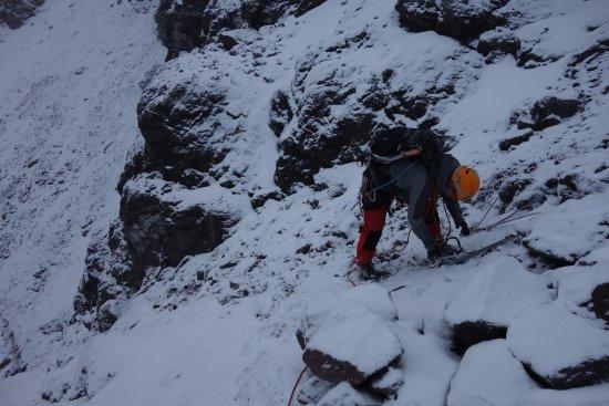 Machachi, Equador: Diego Cumbajin expertly preparing ropes for a belay on Iliniza Sur