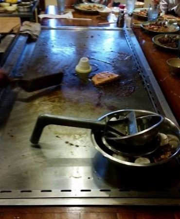Independence, MO: Kobe volcano at end of meal and trash bowl on grill