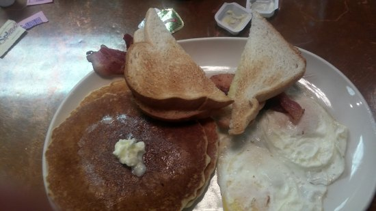 The Olde Mill Restaurant: Tough and Crusty Pancakes with Over-Done Eggs and a Side of Unevenly Cooked Bacon...Yum!!