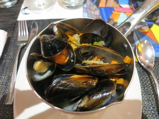 Strand, Sør-Afrika: Muscheln in Weinsoße