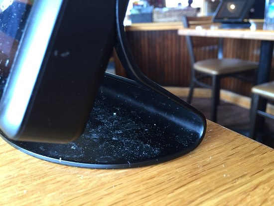 Applebee's : The card readers/paying machines on all the tables are filthy.