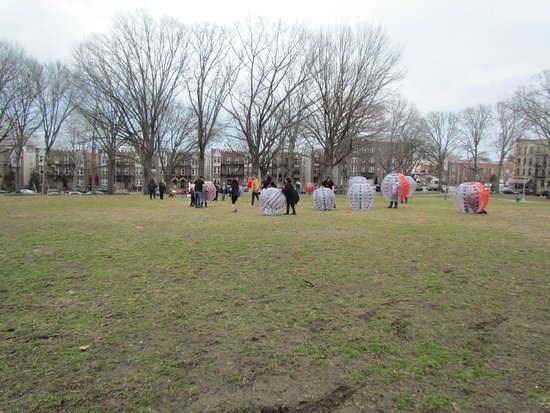 Astoria, NY: On the great lawn -children with balloon type outfits
