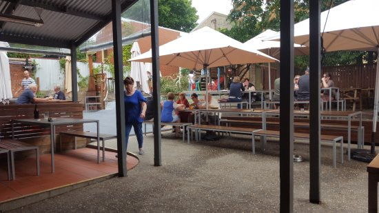 A nice shaded outdoor area and kids playground.