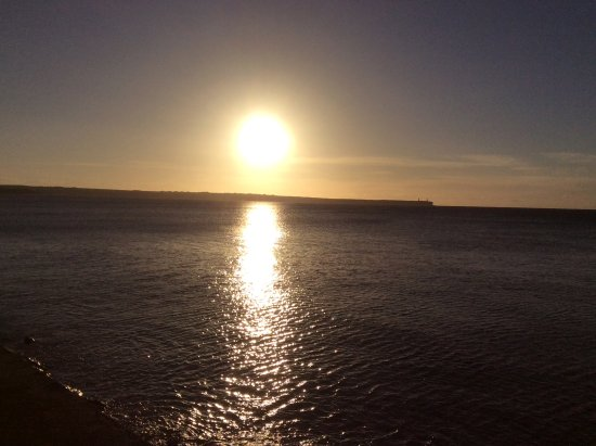 Sun setting on brownstown head across tramore bay / view from balcony