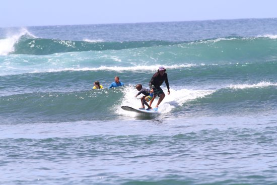 Haleiwa, HI: My 6 year old and Jimmy tandem surfing.