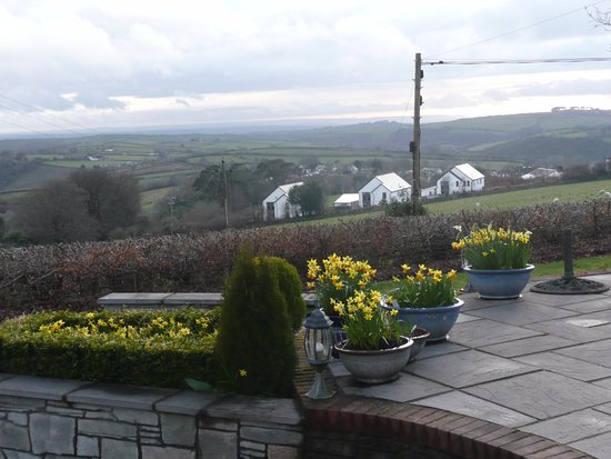 Bratton Fleming, UK: your own patio with a 35 mile view. sunloungers/chairs