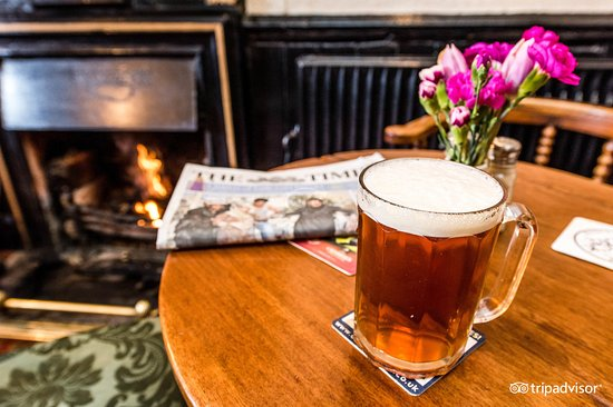 Broadway, UK: Beer and Newspaper on the table