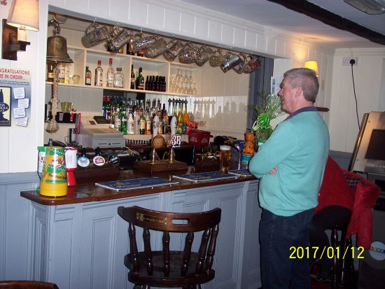 Highworth, UK: The public bar and a customer