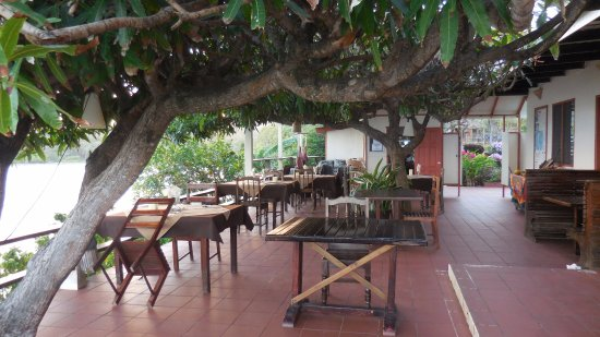 Crochu, Grenada: outdoor dining area with views of the bay