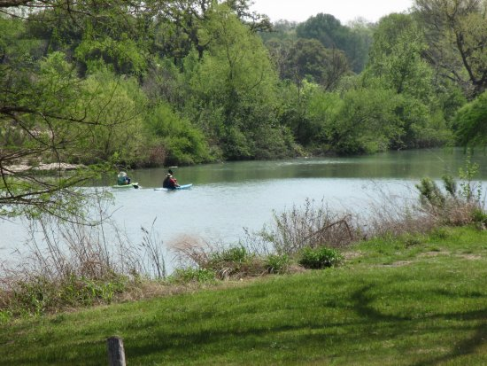 Kayakers enjoying The Blanco River in Blanco State Park