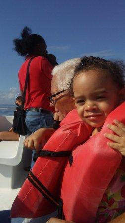 Santa Barbara de Samana, Dominican Republic: Our grand baby on trip, Your guide Roberto in background