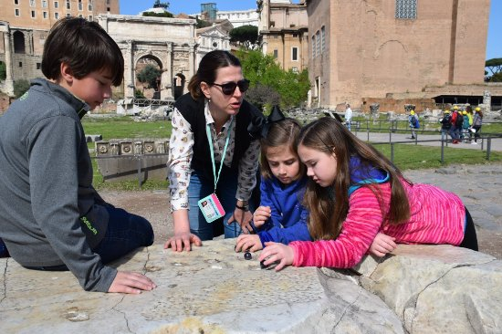 Rome Tours With Kids - Private Tours: playing an ancient marble game at the Roman Forum Ruins
