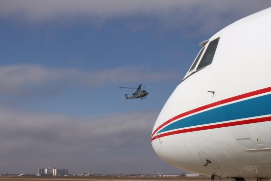 Texas Air & Space Museum : A Bell helicopter being tested flies past the NASA training plane.