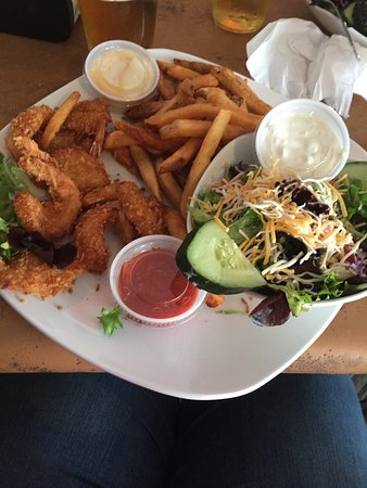 Merritt Island, FL: coconut shrimp side salad, fries and pina colada dipping sauce.