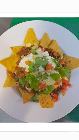 Monsoons: Big bowl of crisp nachos smothered in guacamole,sour cream,Mexican salsa, jalapeños & melted che