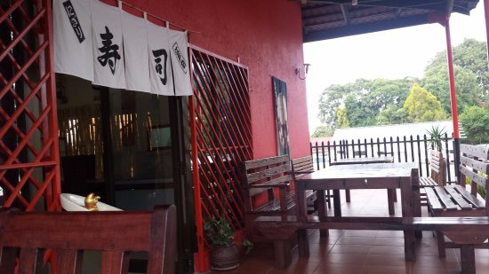 Dining Table And Entrance Of The Restaurant