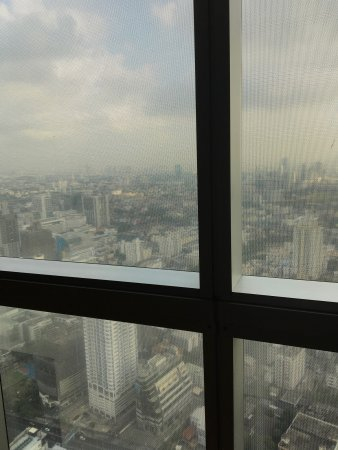 Baiyoke Sky Hotel: Info,Complimentary water,View from room obscured by netting!