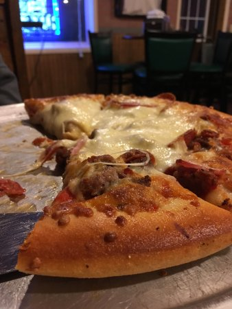 Casey, IL: Garlic knots and meat pan pizza.