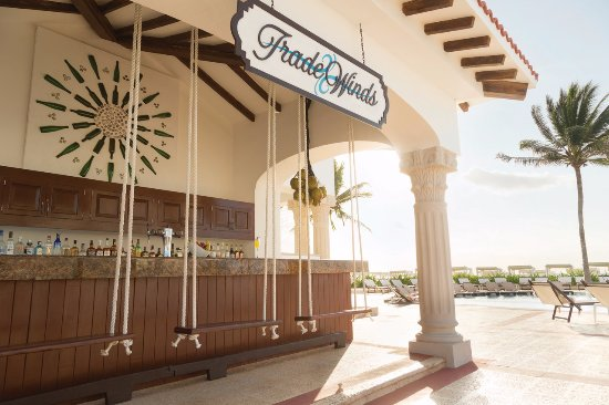 Trade Winds - Enjoy a glass of wine, cold beer or a refreshing cocktail at this poolside bar