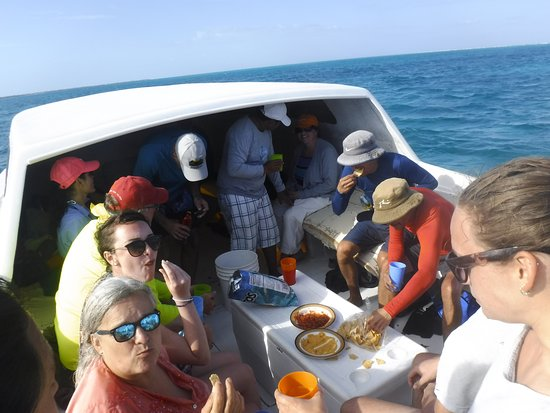 Frenchie's Diving Services: Enjoying rum punch and chips at the end of the trip