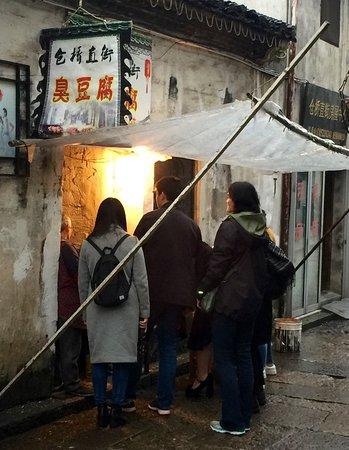"Shaoxing, China: Buying ""stinky tofu"" on Cangqiao Street"