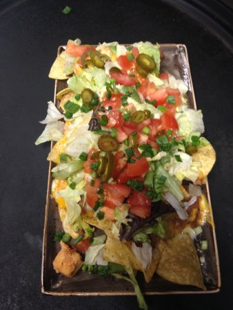 Cheboygan, MI: Great Mexican selection on our menu ~ Chicken nachos in picture, beef and pork versions availabl