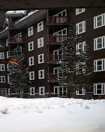 View of the Inner Court of South Lake Tahoe Vacation Resort with Snowfall