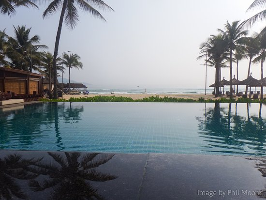 Furama Resort Danang: Looking out from the infinity pool...
