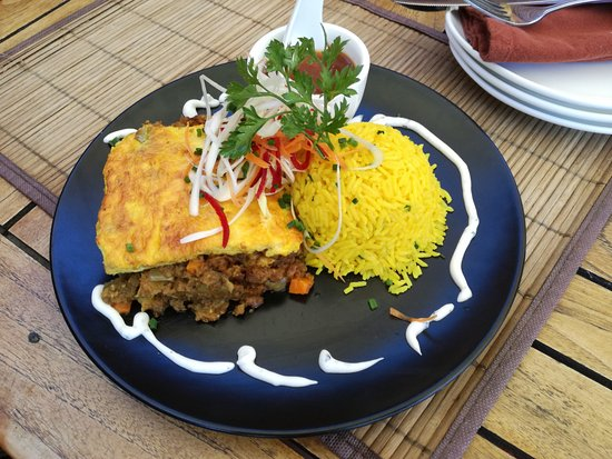 Rick's Cafe Americain - Restaurant and Bar: The special for the day......Bobotie and rice, with own home-made chutney
