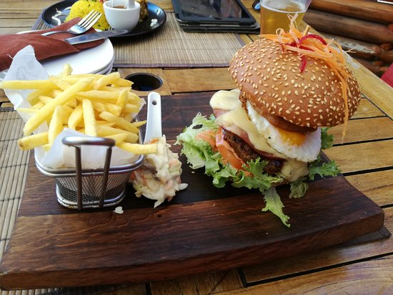 Rick's Cafe Americain - Restaurant and Bar: The burger with Emmentaler cheese, Gypsy ham, fried egg and onion marmalde.