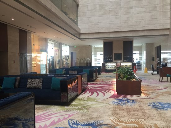 . Modern hotel with beautiful decor  rooftop pool  spacious rooms  and